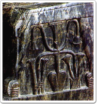 The sema-tawi symbol between the legs of Khefren's throne.