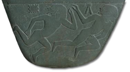 Two slain enemies, each perhaps representing a city or village that was conquered by Narmer.