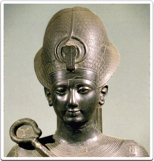 Head of a statue of Ramesses II, wearing the blue crown.