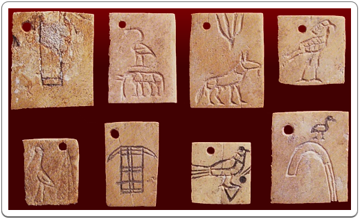 Several inscribed bone tags from tomb U-j at Umm el-Qa'ab, the oldest examples of writing known to mankind.