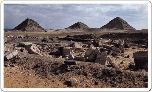 The scanty remains of Userkaf's Solar Temple at Abusir, with the pyramids of  Sahure, Neferikare and Niuserre in the background.